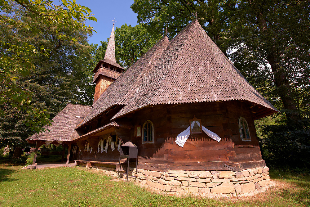 Wooden Church of The Nativity of The Holy Mother ( Nasterea Maicii Domnului ) , Harnicesti, Maramures, Northern Transylvania, Romania. .<br /> <br /> Visit our ROMANIA HISTORIC PLACXES PHOTO COLLECTIONS for more photos to download or buy as wall art prints https://funkystock.photoshelter.com/gallery-collection/Pictures-Images-of-Romania-Photos-of-Romanian-Historic-Landmark-Sites/C00001TITiQwAdS8<br /> .<br /> Visit our MEDIEVAL PHOTO COLLECTIONS for more   photos  to download or buy as prints https://funkystock.photoshelter.com/gallery-collection/Medieval-Middle-Ages-Historic-Places-Arcaeological-Sites-Pictures-Images-of/C0000B5ZA54_WD0s