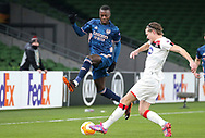 Nicolas Pepe of Arsenal with Dundalk's Daniel Cleary during the Europa League Group B match between Dundalk and Arsenal at Aviva Stadium, Dublin, Republic of Ireland on 10 December 2020.