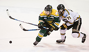 Victoria Grizzlies forward Tyler Welch checks Powell River Kings forward Liam Lawson at the Q Centre in Colwood, British Columbia Canada on March 27, 2017.