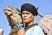 moroccan man with his camel in the atlas mountains Morocco travel photography