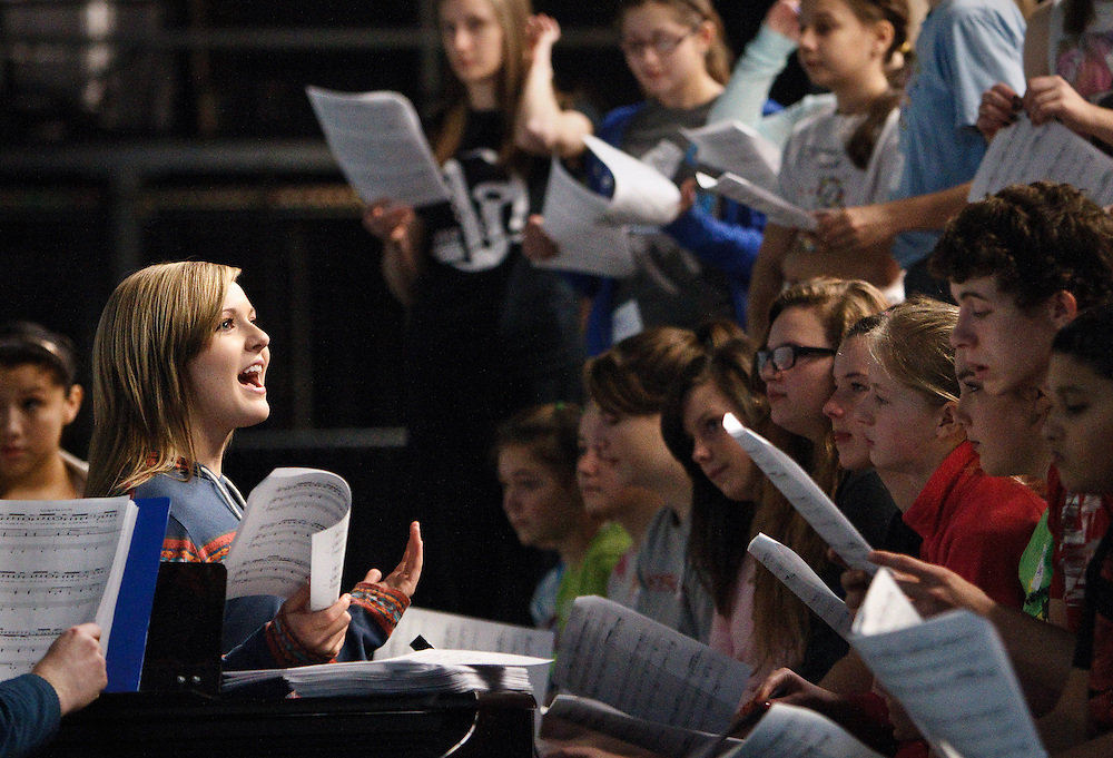 Senior Cory Sorahan goes over music with seventh- and eighth-graders during show choir camp Saturday at Grand Island Senior High. Over 100 kids from grades three through eight were registered for the annual two-day camp that gives kids a chance to experience show choir with the help of seniors at Senior High and professional choreographers. (Independent/Matt Dixon). (Independent/Matt Dixon)