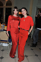 Left to right, SIENNA GUILLORY and LARA BOHINC at a VIP dinner hosted by Maserati following the unveiling of the new Maserati 'Quattroporte' at The Hurlingham Club, London on 17th April 2013.