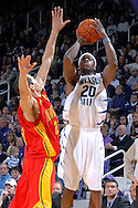 Kansas State forward Cartier Martin (20) hits a three pointer over Iowa State's Chris Ceaser (23) in the second half at Bramlage Coliseum in Manhattan, Kansas, February 17, 2007.  Martin scored 17 points as K-State defeated Iowa State 65-47.