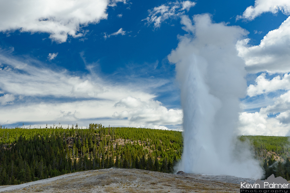 Old Faithful Geyser erupts on a September morning.
