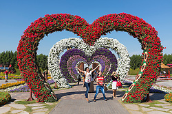 Flower covered love heart arches  at  Miracle Garden the world's biggest flower garden in Dubai United Arab Emirates