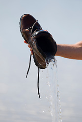 water being removed from a hiking boot