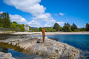 Antony Gormley sculpture GRIP of an abstract human form looking out over Saddell Bay, Kilbrannan Sound to Arran, Saddell Castle in background in Kintyre, Scotland