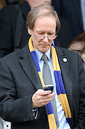 Erik Samuelson, the AFC Wimbledon chairman on the phone after full time. Skybet football league two match, Wycombe Wanderers  v AFC Wimbledon at Adams Park  in High Wycombe, Buckinghamshire on Saturday 2nd April 2016.<br /> pic by John Patrick Fletcher, Andrew Orchard sports photography.