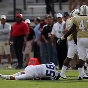Memphis wide receiver Tannar Rehrer (85) gets knocked out of the game by Central Florida linebacker Terrance Plummer (41) during an NCAA football game between the Memphis Tigers and the Central Florida Knights at Bright House Networks Stadium on Saturday, October 29, 2011 in Orlando, Florida.(AP Photo/Alex Menendez)