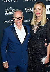 L-R: Designer Tommy Hilfiger and Dee Ocleppo Hilfiger attend the Harper's Bazaar Icons by Carine Roitfeld celebration at The Plaza Hotel in New York, NY on September 8, 2017.  (Photo by Stephen Smith/SIPA USA)