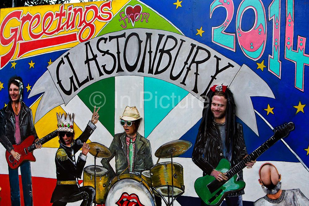 Photo booth at the Glastonbury Festival.<br /> Glastonbury Festival is the largest greenfield festival in the world, and is now attended by around 175,000 people. It's a five-day music festival that takes place near Pilton, Somerset, England. In addition to contemporary music, the festival hosts dance, comedy, theatre, circus, cabaret, and other arts. It is organised by Michael Eavis on his own land, Worthy Farm in Pilton. Leading pop and rock artists have headlined, alongside thousands of others appearing on smaller stages and performance areas.