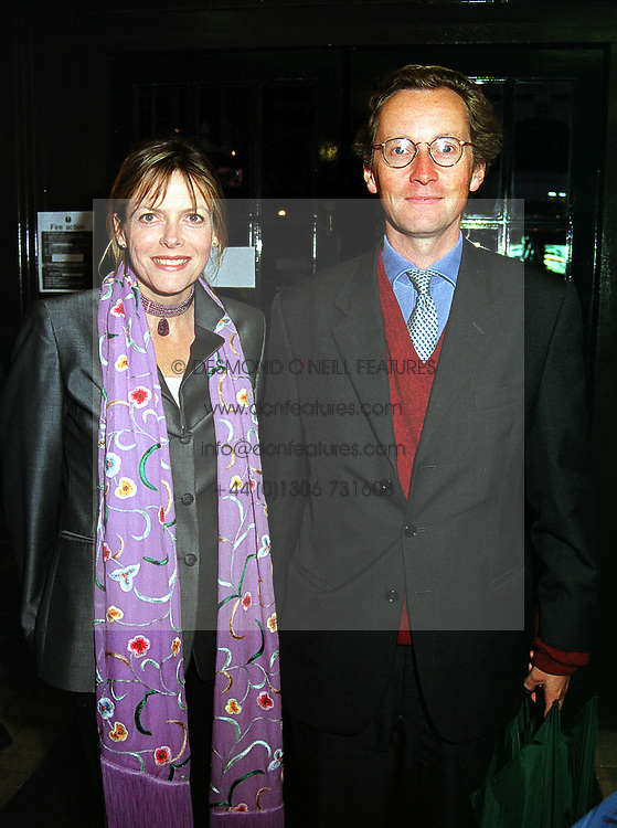 The EARL OF WOOLTON and MISS CAROL CHAPMAN, at a party in London on 14th September 1999.MWH 30