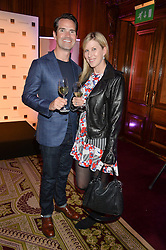 """JIMMY CARR and KAROLINE COPPING at the presentation of Le Prix Champagne De La Joie de Vivre to Stephen Webster in celebration of his long standing contribution to """"Joie de Vivre' held at the Council Room, One Great George Street, London on 22nd April 2015."""