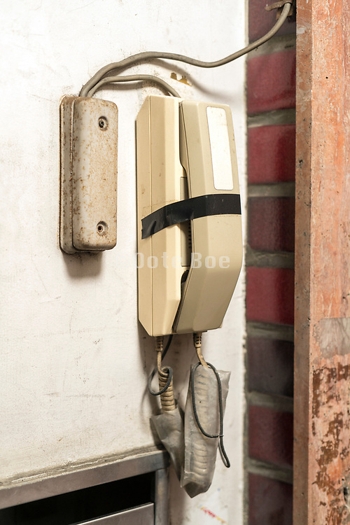 taped up in disuse broken old style intercom telephone