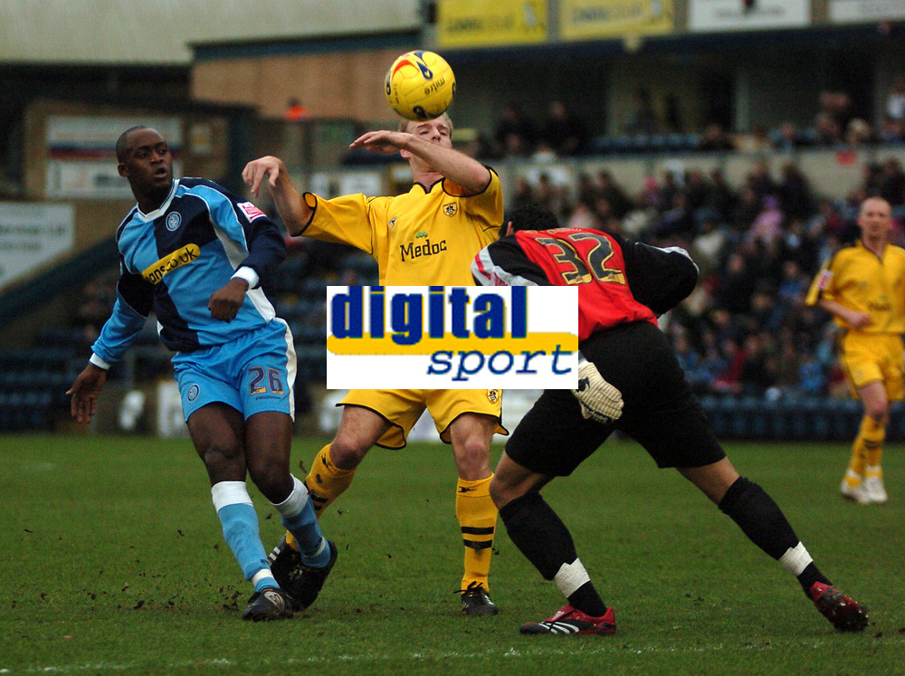 Photo: Tony Oudot.<br />Wycombe Wanderers v Notts County. Coca Cola League 2. 10/02/2007.<br />Wycombe keeper Jamie Young clears with his head from Lawrie Dudfield of Notts County and Leon Crooks of Wycombe