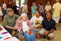 Brenda Moulton, Gladys Burbank, Karen Moulton and Bob Jackson welcome dozens of family and friends for Gladys' surprise 100th birthday celebration at Leavitt Park on Saturday afternoon.  (Karen Bobotas/for the Laconia Daily Sun)