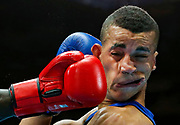 Kenya's Denis Okoth lands a punch on England's Samuel Maxwell during their men's Light Welterweight boxing fight at the Commonwealth Games in Glasgow, Scotland, July 27, 2014.   <br /> REUTERS/Jim Young