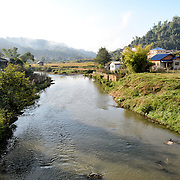 View of the landscape adjacent to Sam Neua (also spelled Samneua, Xamneua and Xam Neua) in northeastern Laos. This shot was taken from one of the town's main bridges.