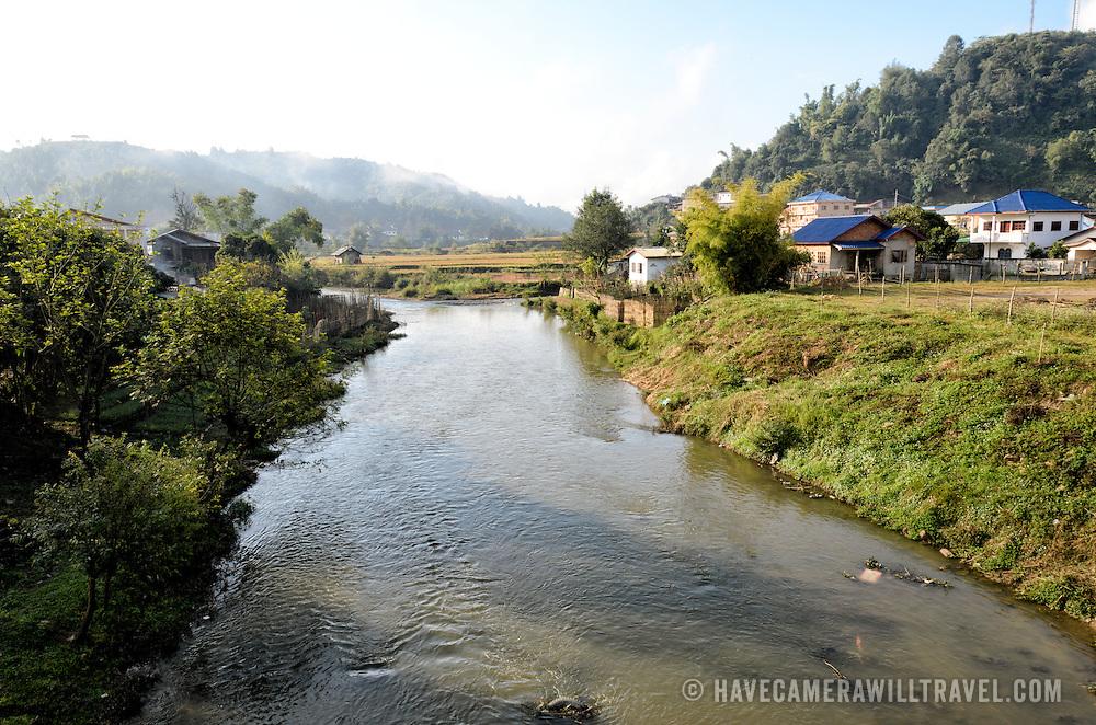 View of the landscape adjacent to Sam Neua (also spelled Samneua, Xamneua and Xam Neua) in northeastern Laos. This shot was taken from one of the town's main bridges.