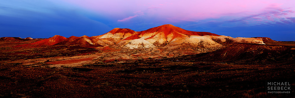 Early dawn light illuminates rugged eroded hills in the South Australian outback.<br /> <br /> Limited Edition Print