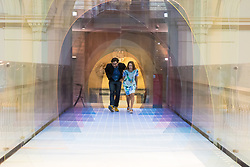 "London, September 18th 2015. Designers Laetitia de Allegri and Matteo Fogale present their installation ""Mise en Abyme"", made of coloursed acryllic panels layered across the length of the V&A's Medieval Renaissance Bridge and presenting an interpretation of perspective in a three dimensional space. The Victoria and Albert museum celebrates the London Design Festival runs from 19 – 27 September  with a collection of conceptual installation artworks."
