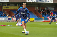 AFC Wimbledon midfielder Max Sanders (23) warming up during the EFL Sky Bet League 1 match between AFC Wimbledon and Rochdale at the Cherry Red Records Stadium, Kingston, England on 5 October 2019.