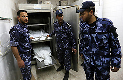 May 6, 2018 - Gaza City, Gaza Strip, Palestinian Territory - Palestinian police officers loyal to Hamas look on the bodies of martyrs, who were killed in an explosion, at a hospital morgue in the central Gaza Strip, on May 5, 2018  (Credit Image: © Ashraf Amra/APA Images via ZUMA Wire)