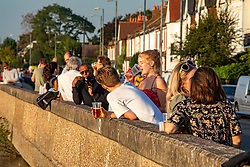 © Licensed to London News Pictures. 21/09/2020. London, UK. Down the Hatch. Pub drinkers enjoy a pint in the warm sunshine in Barnes, South West London this evening as Prime Minister Boris Johnson is expected to announce tomorrow a 10pm curfew on pubs across England this week after Chief Medical Officer Prof Chris Whitty and Chief Scientific Adviser Sir Patrick Vallance addressed the Nation this morning warning the public that we are in a critical point of the pandemic with increasing coronavirus rates across the country. Photo credit: Alex Lentati/LNP<br /> <br /> Soaring covid 19 cases