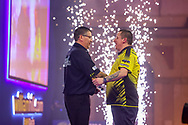 Dave Chisnall congratulates Gary Anderson after Gary Anderson  wins the match during the William Hill World Darts Championship Semi-Finals at Alexandra Palace, London, United Kingdom on 2 January 2021.