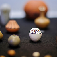 031514       Cable Hoover<br /> <br /> Miniature pots and other pieces by traditional Taos Pueblo potter Pam Lujan-Hauer are on display during a presentation at the Octavia Fellin Public Library in Gallup Saturday.