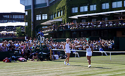 Heather Watson (right) and Naomi Broady celebrate winning their doubles match against Harriet Dart and Katy Dunne against on day four of the Wimbledon Championships at The All England Lawn Tennis and Croquet Club, Wimbledon.