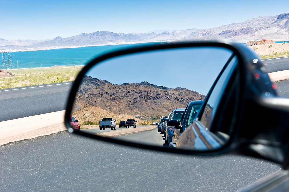 Reflection of a car line in a congested route