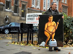 © Licensed to London News Pictures. 29/11/2011, London, UK.  KAYA MAR carries his satirical painting of George Osborne along Abingdon Street, London. Politicians and Union leaders talk to the media on College Green, London, a day before an estimated 2.6 million people will march through London protesting against the Governments controversial pension plans. Photo credit : Stephen Simpson/LNP