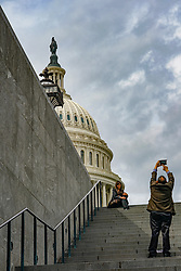 A tourist taking a photo of the US Congress building in Washington DC in the United States. From a series of travel photos in the United States. Photo date: Friday, March 30, 2018. Photo credit should read: Richard Gray/EMPICS