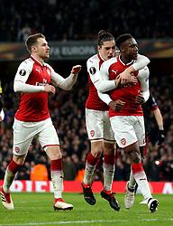 Danny Welbeck of Arsenal celebrates with teammates after scoring a goal to make it 2-1 - Mandatory by-line: Robbie Stephenson/JMP - 15/03/2018 - FOOTBALL - Emirates Stadium - London, England - Arsenal v AC Milan - UEFA Europa League Round of 16, Second leg
