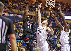 Dec 14, 2019; Morgantown, WV, USA; Nicholls State Colonels forward Warith Alatishe (25) shoots over West Virginia Mountaineers forward Logan Routt (31) during the first half at WVU Coliseum. Mandatory Credit: Ben Queen-USA TODAY Sports