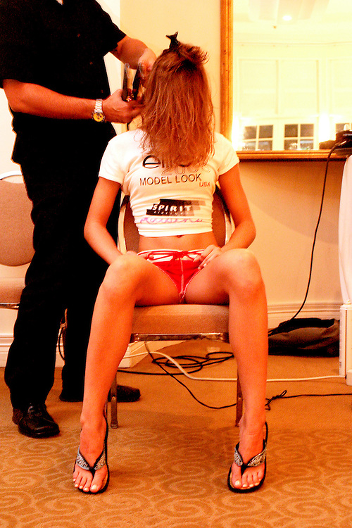 Nineteen-year-old contestant Amanda Hall of Morgantown, W. Va. getting her hair styled at the national Elite Model Look 2003 contest at The Palms Hotel in Miami Beach