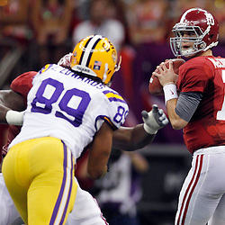 Jan 9, 2012; New Orleans, LA, USA; Alabama Crimson Tide quarterback A.J. McCarron (10) drops back to pass during the second half of the 2012 BCS National Championship game against the LSU Tigers at the Mercedes-Benz Superdome.  Mandatory Credit: Derick E. Hingle-US PRESSWIRE