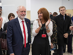 © Licensed to London News Pictures. 29/10/2019. London, UK. Labour Party Leader Jeremy Corbyn is applauded by Karie Murphy, election campaign strategist, as Director of Communications Seumas Milne (R) looks onat headquarters as he announces his support an early general election. The government are expected to call for another vote on a general election in Parliament later today. Photo credit: Peter Macdiarmid/LNP
