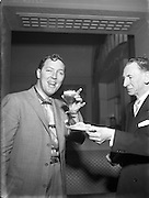 """Bill Haley - the Rock and Roll King visits Dublin.27/02/1957. Bill Haley (06/07/1925 – 09/02/1981) was one of the first American rock and roll musicians. He is credited by many with first popularizing this form of music in the early 1950s with his group Bill Haley & His Comets and their hit song """"Rock Around the Clock""""."""