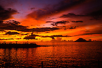 Indonesia, Sulawesi, Manado. A colourful sunset seen from Sunset Cafe. Manado Tua in the background.
