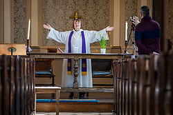 © Licensed to London News Pictures. 22/03/2020. London, UK. Reverend Anne Bennett delivers the Mothering Sunday service to parishioners via live-stream at the Church of the Ascension in Blackheath, south London. In response to government advice on social distancing and non-essential contact, the Church of England has suspended public worship until further notice to help slow the spread of the Coronavirus. Photo credit: Rob Pinney/LNP