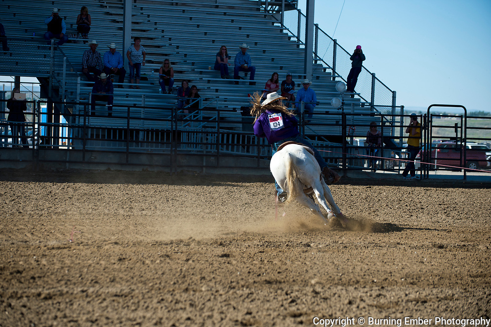 Bailee Peterson and Jessica Hathaway in the Team Roping event Friday morning go at the Wyoming State High School Finals Rodeo in Rock Springs Wyoming.  Photo by Josh Homer/Burning Ember Photography.  Photo credit must be given on all uses.