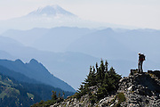 Brian Polagye looks out towards Mount Adams from the Tatoosh Range in Mount Rainier National Park, Washington.