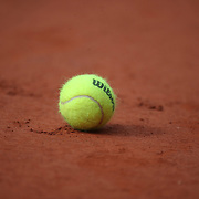 PARIS, FRANCE September 26.  A Wilson tennis ball, the official tennis ball of the tournament, on the clay surface at the 2020 French Open Tennis Tournament at Roland Garros on September 26th 2020 in Paris, France. (Photo by Tim Clayton/Corbis via Getty Images)