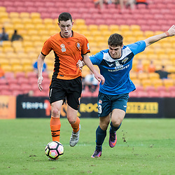 BRISBANE, AUSTRALIA - MARCH 25: Daniel Leck of the Roar and Matthew Williams of SWQ Thunder compete for the ball during the round 5 NPL Queensland match between the Brisbane Roar and SWQ Thunder at Suncorp Stadium on March 25, 2017 in Brisbane, Australia. (Photo by Patrick Kearney/Brisbane Roar)