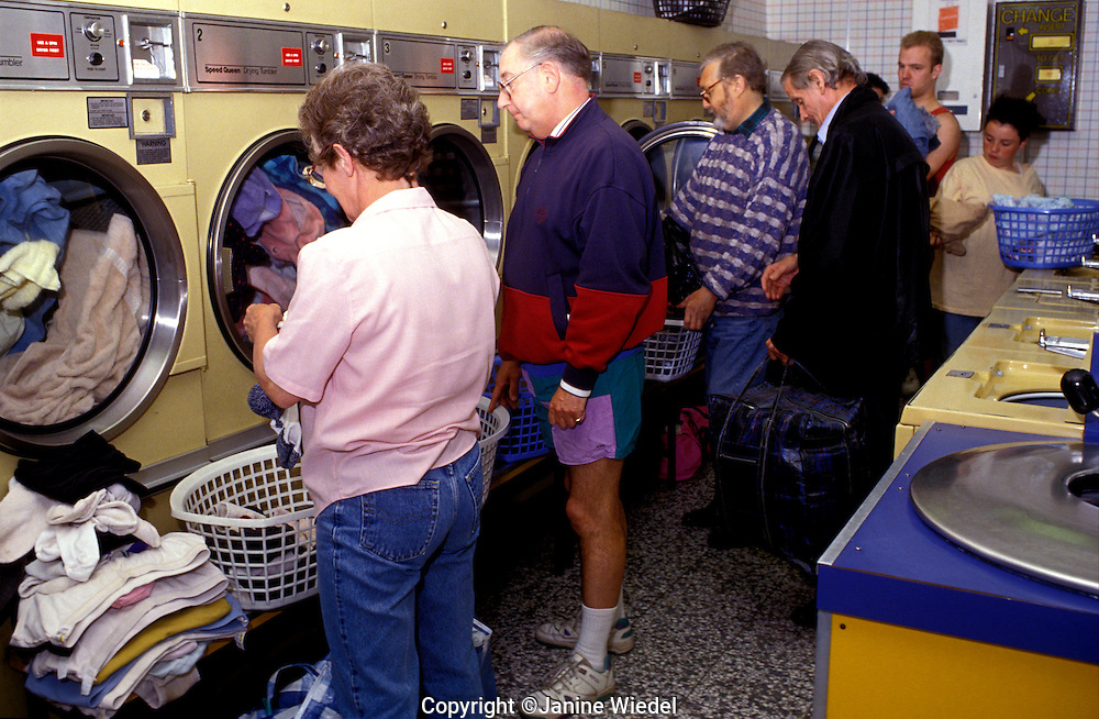 People doing their washing at the Launderette, London..