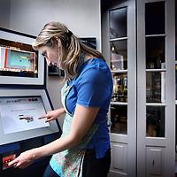 Nederland, Amsterdam , 29 april 2014.<br /> Bitcoin apparaat in koffiehuis Hofje van Wijn op de Zeedijk.<br /> Aan het Hofje van Wijs aan de Zeedijk 43 te Amsterdam (drie minuten lopen van Amsterdam Centraal) staat sinds deze week de eerste Bitcoin-ATM (of: BTM) van de stad. Het gaat om een DualFly van BTC-O-Matic, die bitcoin verkoopt voor papiergeld (maar niet andersom).<br /> De BTM was eerder al in Amsterdam te vinden, hij stond namelijk ook op de Bitcoinference: de Bitcoin-conferentie die onlangs was georganiseerd op het Science Park. Het apparaat zal nu in het Hofje van Wijs blijven staan tot hij wordt verkocht.<br /> Aanstaande woensdag zal de BTM worden ingehuldigd tijdens de Dutch Ethereum & Bitcoin Meetup.<br /> <br /> Bitcoin is een vorm van electronisch geld en tevens de naam van de opensourcesoftware die is ontworpen om dit te gebruiken.<br /> Bitcoins kunnen worden opgeslagen op een personal computer in de vorm van een wallet bestand of worden beheerd door een derde partij, een portemonneedienst.<br /> In beide gevallen kan het geld naar een ander persoon worden verzonden via het internet door iedereen met een Bitcoinadres.<br /> Foto:Jean-Pierre Jans