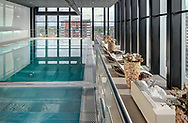 Pool at wellness spa in Level in Leiden, designed by MVSA-Architects. A multi purpuse building housing a school, hotel, spa and offices.