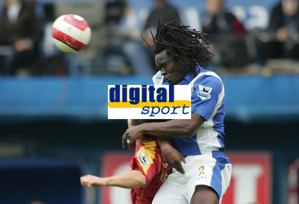 Photo: Lee Earle.<br /> Portsmouth v Reading. The Barclays Premiership. 28/10/2006. Portsmouth's Linvoy Primus (R) clears.